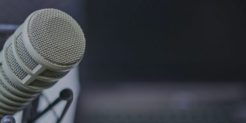 Podcast microphone with laptop
